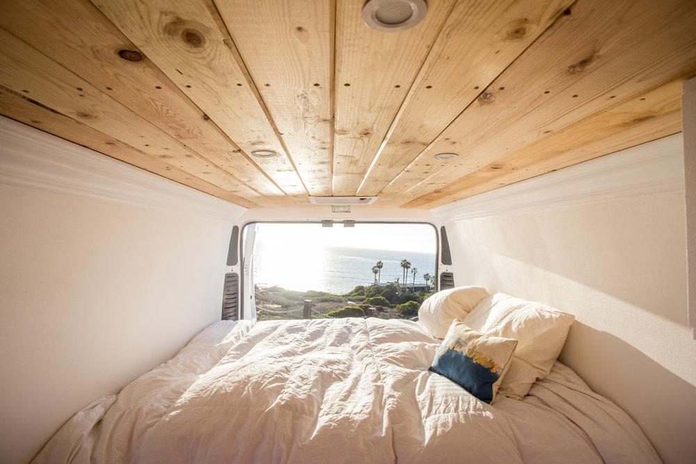 D & M supplies inside a camper van with mattress